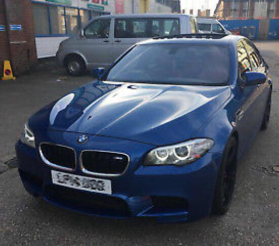 BMW M5 with red leather interior, black 20 inch alloys